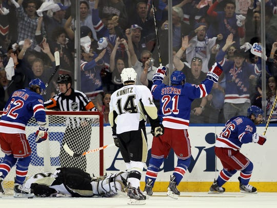Rangers celebrate a goal by Martin St. Louis against the Pittsburgh Penguins.