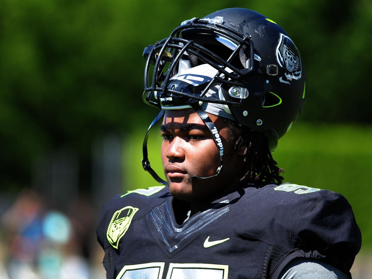 Defensive lineman Rashan Gary looks on from the sideline during The Opening at Nike World Headquarters in 2014.