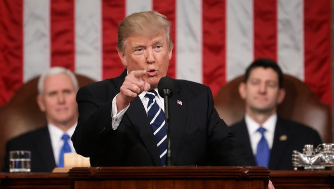 FILE - In this Feb. 28, 2017, file photo, President Donald Trump addresses a joint session of Congress on Capitol Hill in Washington. as Vice President Mike Pence and House Speaker Paul Ryan of Wis. listen. Trump will deliver his first State of the Union address on Tuesday, Jan. 30, 2018.