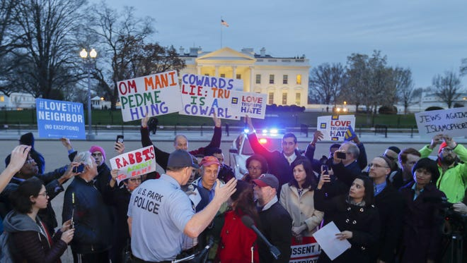 Park Police move a protest against President Trump's revised executive order barring travel visas from six Muslim-majority countries in Lafayette Park outside the White House Monday.