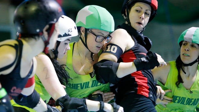 "Playing for the San Francisco ShEvil Dead, skater Veronica De La Rosa, known as ""Sterling Archer,"" center, battles for position against the Oakland Outlaws' blockers during scrimmage night on Thursday, Feb. 9, 2017 in Oakland, Calif. Bay Area Derby (BAD) is home of the Berkeley Resistance, Richmond Wrecking Belles, Oakland Outlaws and San Francisco ShEvil Dead and is a full contact women's flat track roller derby league in Oakland. (Josie Lepe/Bay Area News Group/TNS)"