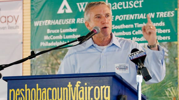 Travis Childers, Democratic nominee for the U.S. Senate seat occupied by incumbent Republican Thad Cochran, addresses the audience at the Neshoba County Fair in Philadelphia, Miss., Thursday, July 31, 2014. The fair is a traditional gathering place for politicians, area residents, business leaders, voters and families. (AP Photo/Rogelio V. Solis)
