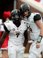 Vanderbilt quarterback Kyle Shurmur (14) celebrates the 38 yard touchdown run by running back Ralph Webb (7) in the first half of an NCAA college football game against Mississippi in Oxford, Miss., Saturday, Oct. 14, 2017. (AP Photo/Rogelio V. Solis)