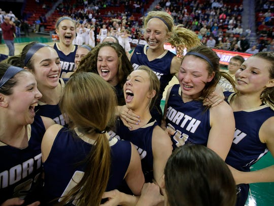 Appleton North players celebrate their victory against De Pere for the WIAA Division 1 state girls basketball title last year at the Resch Center.