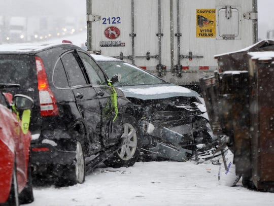 Cars remain at the scene of a multi-vehicle pileup