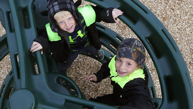 Quinten and Erich Capozzo climb a new piece of playground equipment at the Eden Elementary school Tuesday, October 12. The new playground is the result of a PTO initiative which raised over $30,000 and three weekends of volunteer work. Tuesday October 12, 2015.