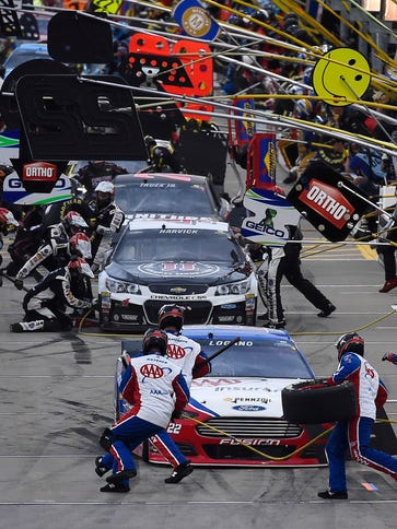 Sprint Cup drivers hit pit road at Kansas Speedway