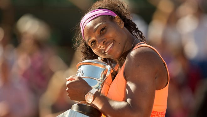 Serena Williams poses with the trophy after her match against Lucie Safarova during the 2015 French Open at Roland Garros.
