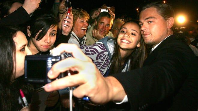 Leonardo DiCaprio with fan Celia Kerr, 13, at the 2009 Palm Springs International Film Festival.