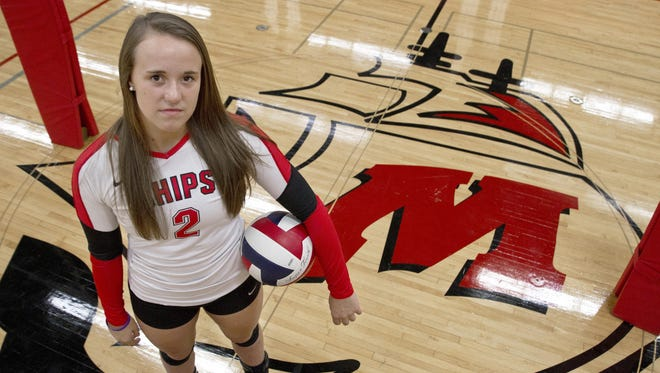 Lincoln volleyball setter Mallory Dixon, 17, poses for a portrait at the school's JFK Fieldhouse Sept. 3.
