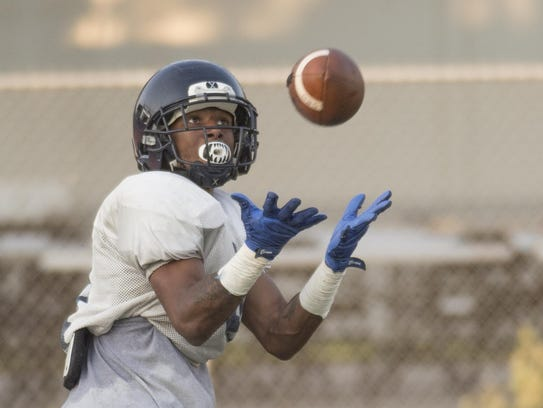 College of the Sequoias' Antonio Parnell takes a pass