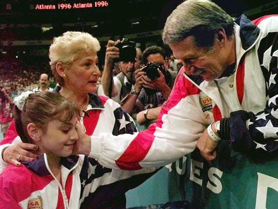 In this July 23, 1996, file photo, Bela Karolyi, right,