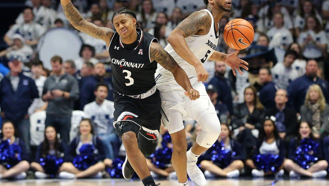 Point guard Justin Jenifer (3) and the Cincinnati Bearcats must tighten up their defense against Florida, after an 89-76 loss at Xavier last week.