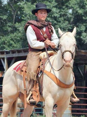 """A volunteers plays the key figure in the Old Lincoln Days pageant """"The Last Escape of Billy the Kid."""""""