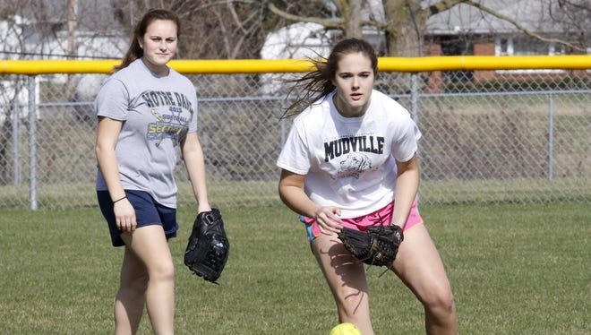 Notre Dame's Alivia Clark fields a ball during practice last week as teammate Izzy Milazzo looks on.