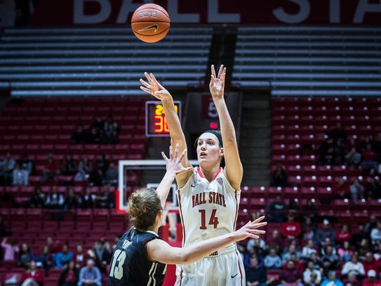 Ball State's Renee Bennett shoots past Purdue's defense