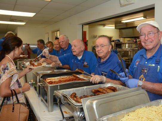 File: Bill Roche, and fellow volunteers man the chow line.
