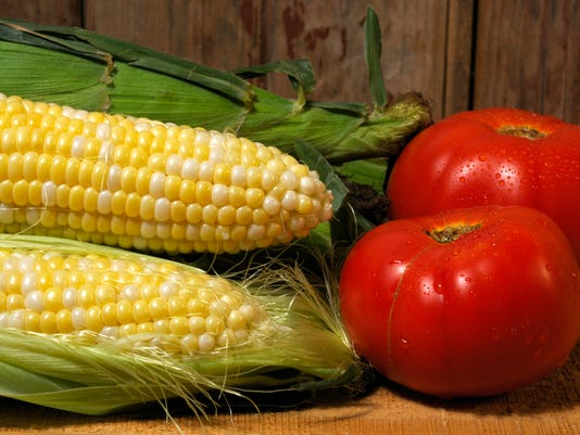 Three Cobs and Tomatoes