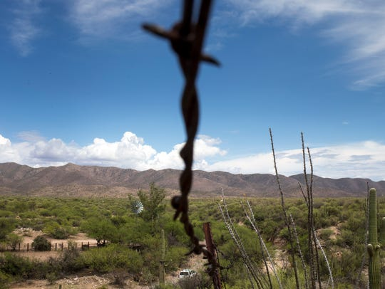 A barbed-wire fence separates the United States and