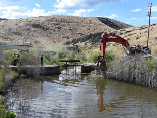Repairs are bring done to the Washoe Lake Dam on Monday.
