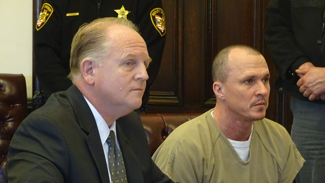 Mark A. Ray, right, of West Lafayette, pleaded guilty Tuesday to attempted murder and other felony charges in the July 11 shooting of his former girlfriend outside Coshocton's Dairy Queen. Public Defender Jeff Mullen, left, appeared with Ray in the Coshocton County Courthouse to answer the charges.