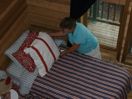 Parm Boyer prepares beds for each guest at the Inspiration Inn Bloom.