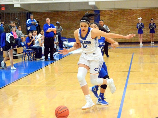 Carlsbad's Kim Best comes up with a steal in the first
