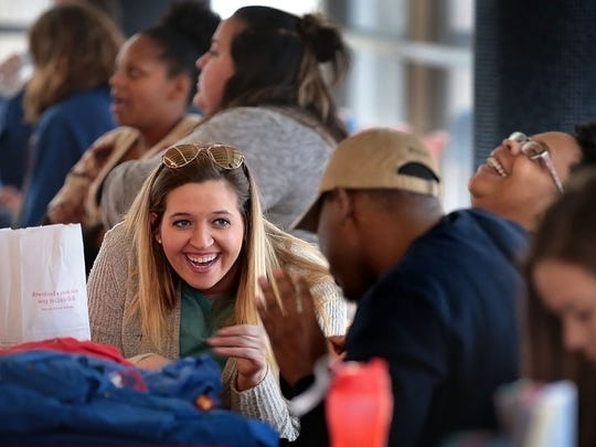 Southwest Tennessee Community College recruiters Amanda Victory (left), Nigel Stephenson, and Shenay Nolan joke around at their booth during a  Community Alliance for the Homeless Memphis Youth Count event at the Cossitt Library downtown.