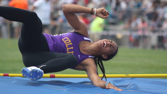 Fort Collins High School's Audra Koopman grimaces after a failed attempt in the high jump Friday. Koopman finished fourth in the event despite a badly injured hamstring.