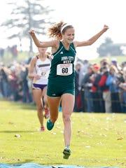 Iowa City West runner Bailey Nock celebrates as she