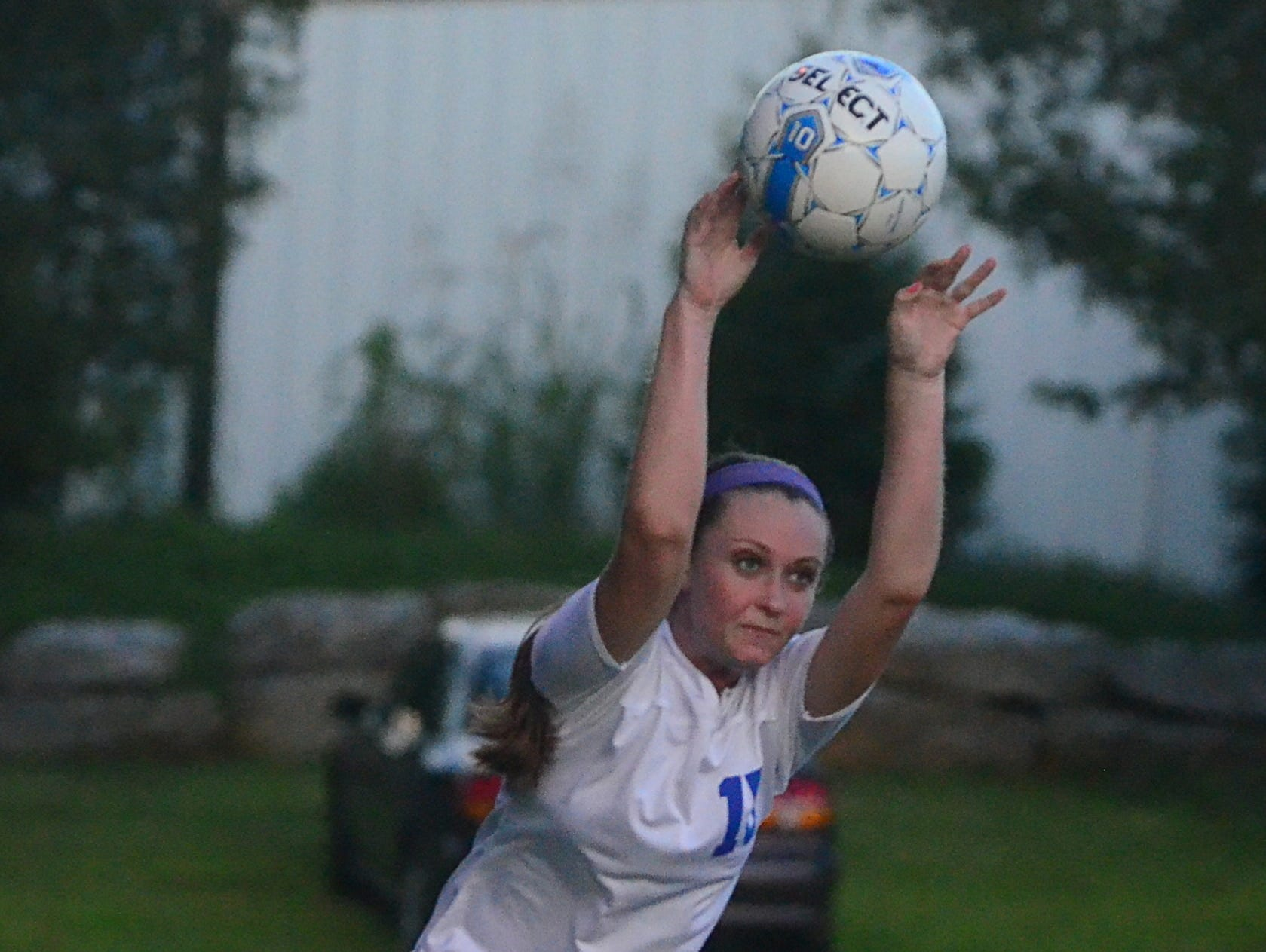 White House High senior Sara McGregor takes a throw-in during first half-action against Station Camp.