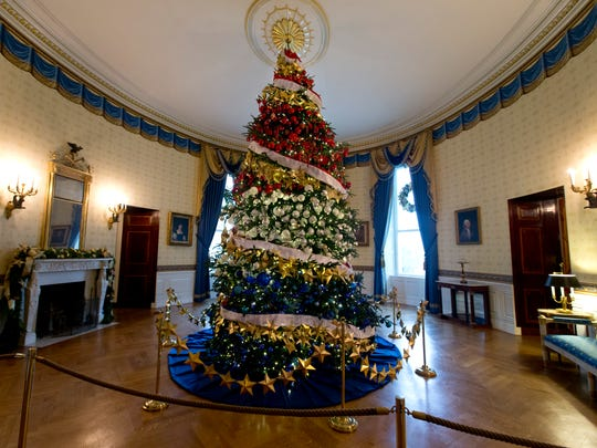 This year's White House Christmas Tree is displayed in the Blue Room of the White House during a preview of the 2015 holiday decor at the White House in Washington, Wednesday, Dec. 2, 2015.