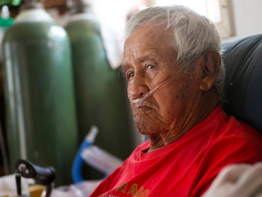 """Charley Colorado, 87, who has pulmonary fibrosis, breathes oxygen through a respirator at his home outside of Gray Mountain on the Navajo Reservation. Colorado worked at a uranium mine in the late 1950s near Cameron. """"They (said) it wasn't dangerous,"""" he said through a translator. Colorado has received compensation and currently receives health care paid for from the U.S. Department of Labor for his uranium mining services."""