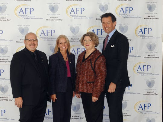 (left to right) Co-chair Ron Willison, Co-chair Andrea Spirtos, President of AFP CA, Desert Communities Chapter Eileen Packer, and Andrew P. Watt, President & CEO of Association of Fundraising Professionals and Keynote Speaker at NPD.