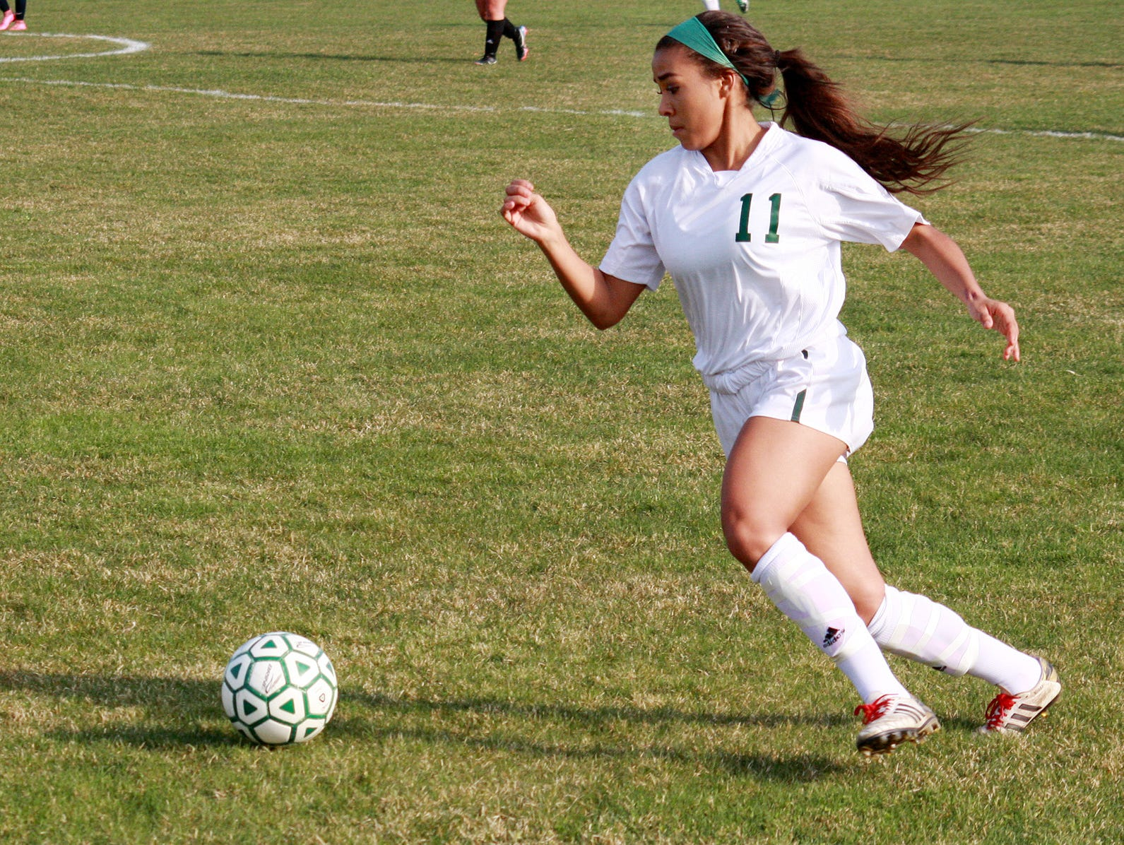 Pennfield's Sonata Beasley takes the ball downfield to score the first goal of the game in action earlier this season.