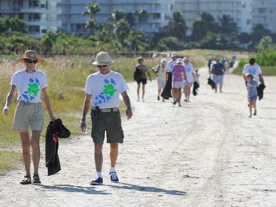 A beach cleanup at  Tigertail Beach from a previous Coastal Cleanup. Lance Shearer/Correspondent