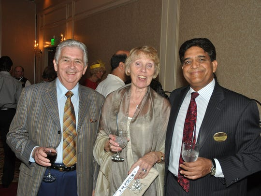 Hilton GM Mac Chaudhry, right, greets Brian and Jan