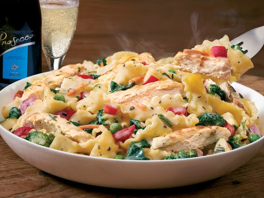 Chicken Giardino: Grilled chicken and a medley of fresh vegetables tossed with pappardelle pasta in a light, lemon chicken herb sauce.