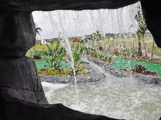 The 18-hole mini golf course at Alico Family Golf Center features a cave and waterfall.