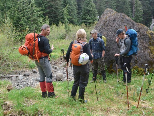 Olympic College mountaineering instructor Kevin Swem, left, briefs students on wilderness safety during a field trip.