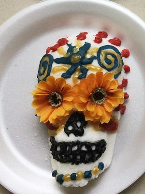 Sugar skulls are often decorated with brightly colored frosting, feathers, beads and even rhinestones. Common decorative motifs included crosses, marigolds, mandalas and all sorts of patterns.