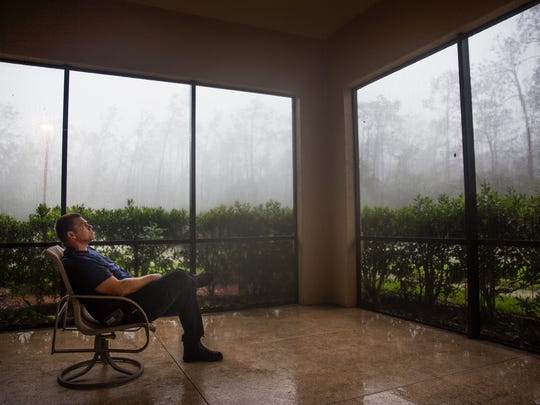 Captain Jason Sellers sits in the lanai as Hurricane Irma continues outside at the Greater Naples Fire Rescue Station 72 on Sunday, September 10, 2017.