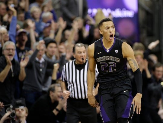 Washington's Dominic Green reacts after sinking a 3-point