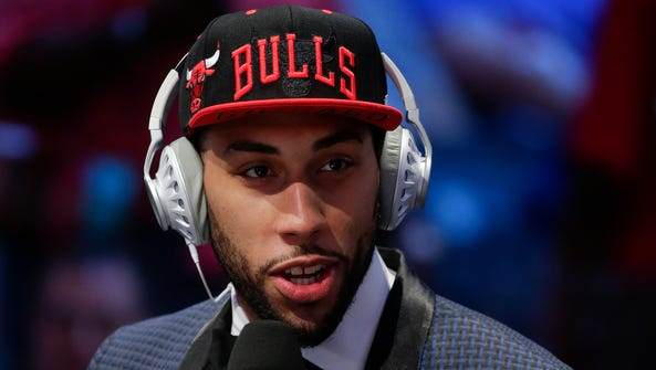 Denzel Valentine answers questions during an interview