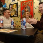 People enjoy Pabst Blue Ribbon beer at Betty's Food and Spirits in Columbus, Ohio, in 2004.