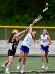 South Western's Annika Hanson and Kennard-Dale's Megan Halczuk fight for possession in the first half of a YAIAA girls' lacrosse semifinal game Wednesday, May 10, 2017, at Red Lion. Kennard-Dale defeated South Western 23-11 to advance to the championship game.