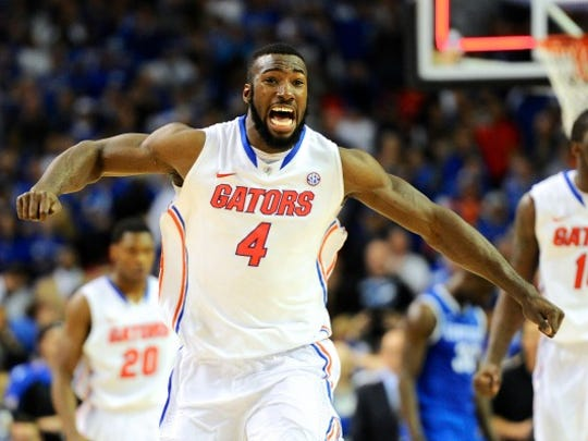 Florida Gators center Patric Young (4) reacts as time