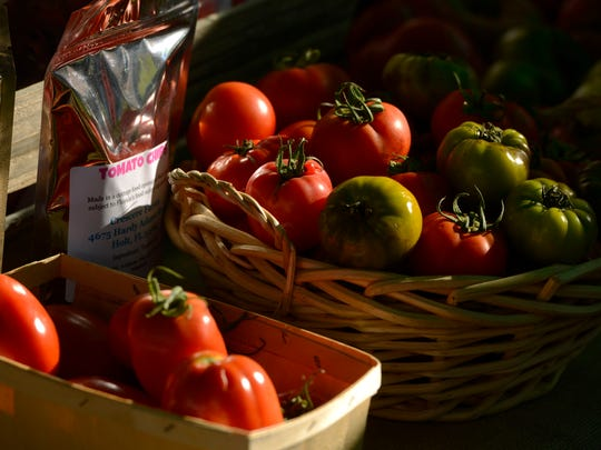 Fresh tomatoes from Crescere Farms for sale Saturday at the Palafox Market in downtown Pensacola.
