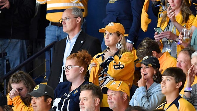Former Nashville Mayor Megan Barry, center, with then-police bodyguard Sgt. Rob Forrest, left, at the 2017 NHL Stanley Cup Finals. Forrest has a $74,000 a year pension.