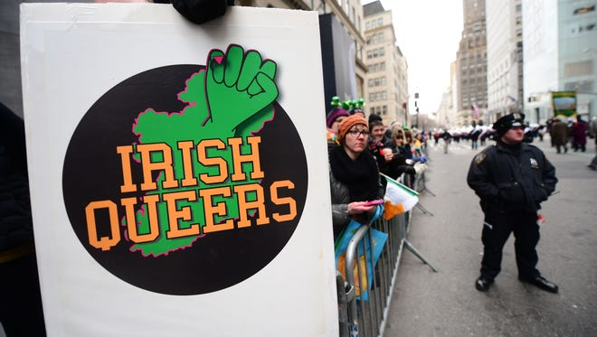 Gay rights supporters protest the exclusion of gay signs and expressions from the St. Patrick's Day parade in New York on March 17, 2014.